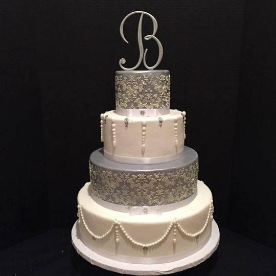 Custom silver and white wedding cake. Handmade pearls, hand piped damask pattern.