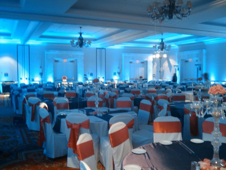 Blue reception lighting and orange chair bands