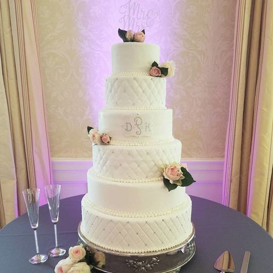 6 tiered, fondant covered with alternating diamond/crystal pattern.