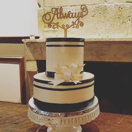 Buttercream barrel cake with fondant accents.