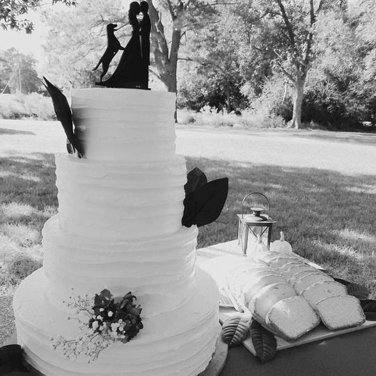 Buttercream with rustic ruffle and magnolia details!
