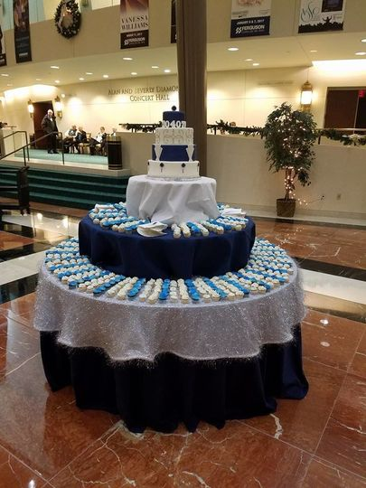 4 tiered fondant covered display cake with 500 cupcake servings.