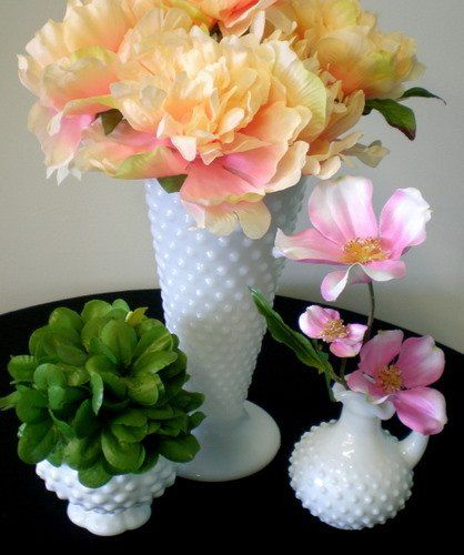 Poppyscott Events has milk glass vases available to rent in Sioux City, IA.