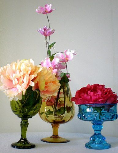 Poppyscott Events, Sioux City, IA wedding planning has colored glass available to rent for...