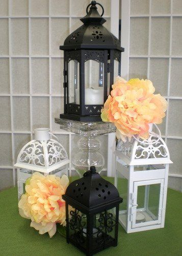 Our party rentals include centerpiece items like these lanterns at Poppyscott Events, Sioux City IA