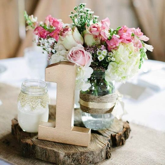wood slices and gold table numbers