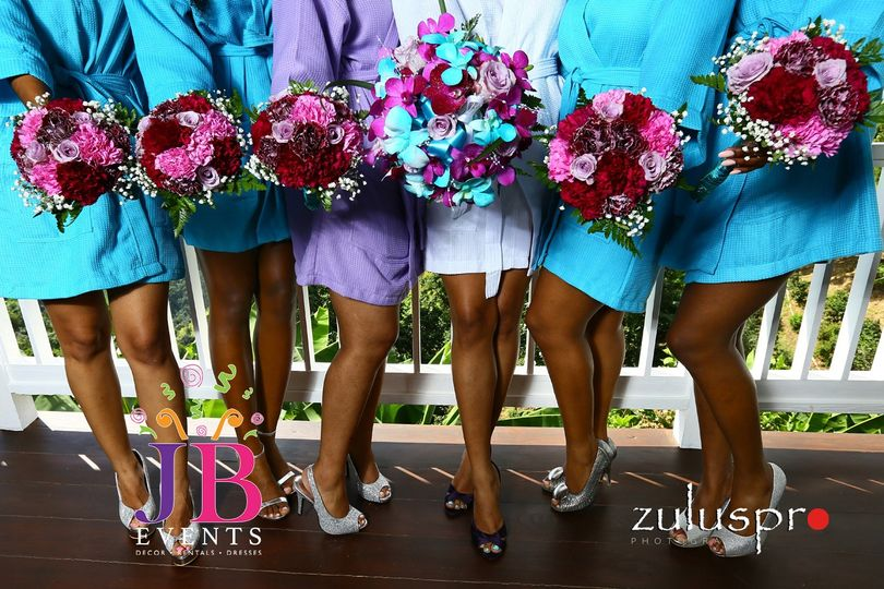 the bride and her abesties strike a pose and show off their bouquets 51 782603 159098474947776