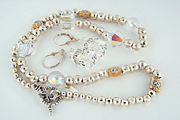 Sterling Silver, Swarovski crystals, vermeil beads.  An absolutely stunning, shimmering piece!!