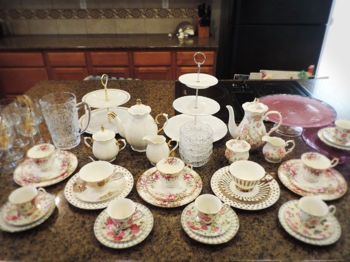 Preparing for a Mother Daughter Tea.  The women sip from vintage Royal Albert fine bone china, while...