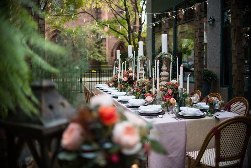 Outdoor table setup with candle centerpiece