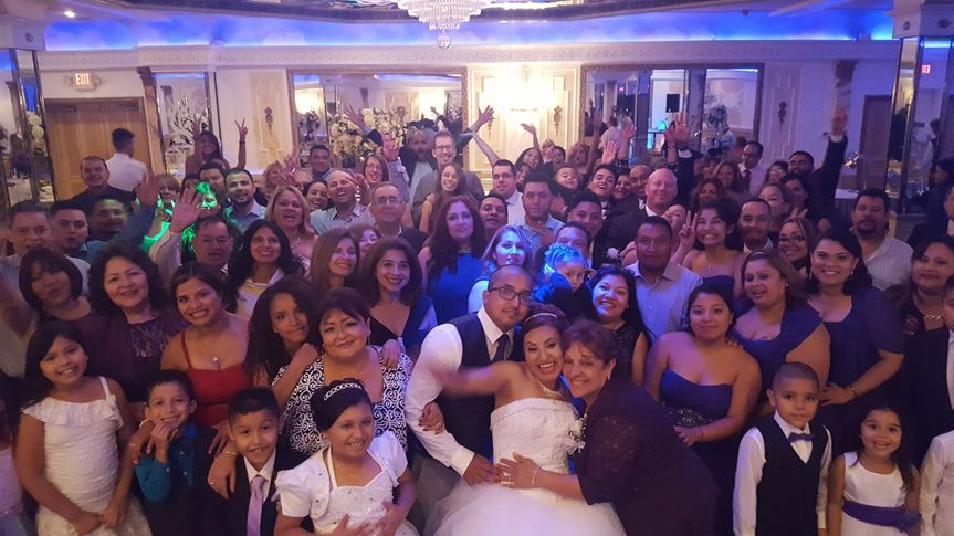 Newlyweds and the guests of the wedding