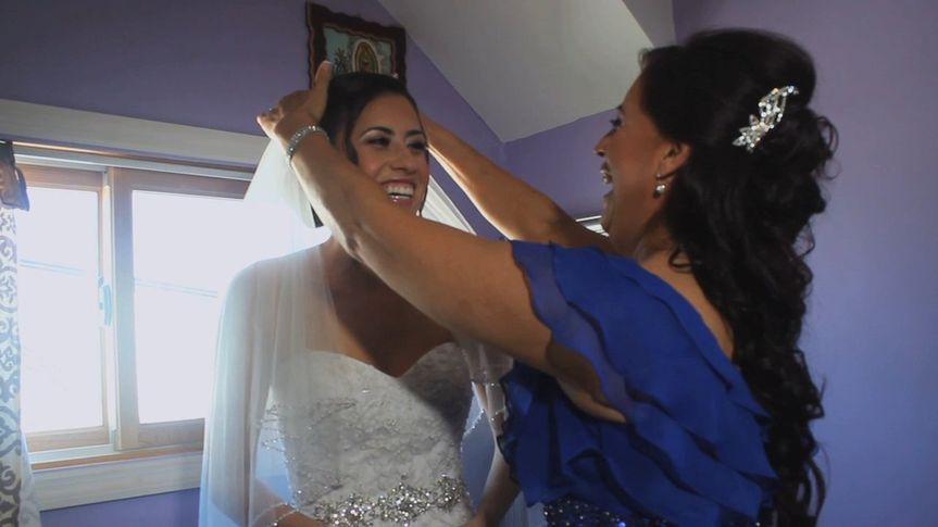 Getting the bride ready - Videography by Matt