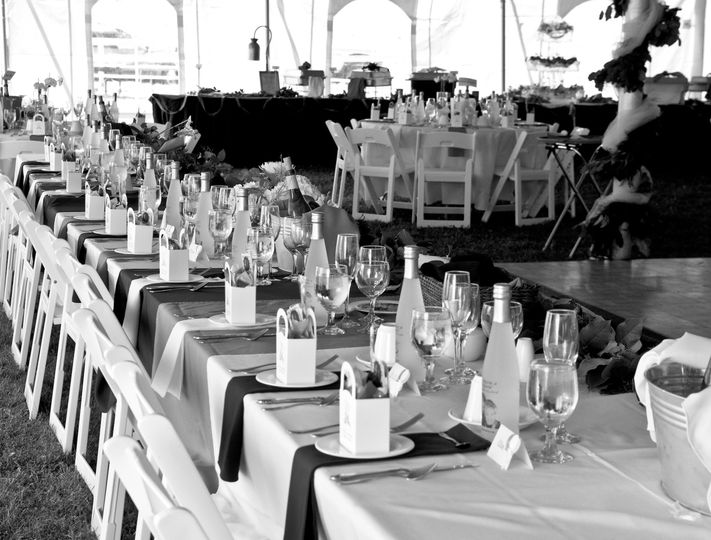 A stunning tent wedding.. each setting set to perfection!