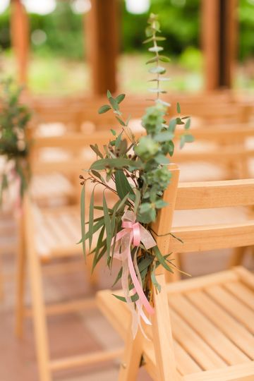 Aisle decoration with pink ribbon