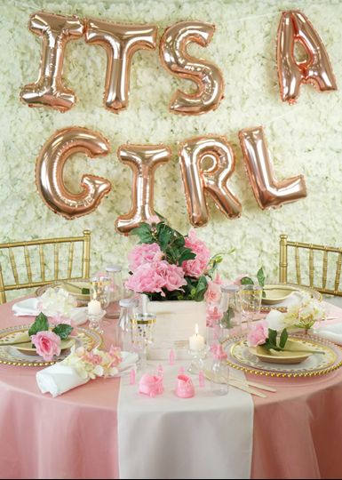 Girl's baby shower table setup
