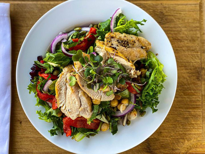 Chicken over salad greens