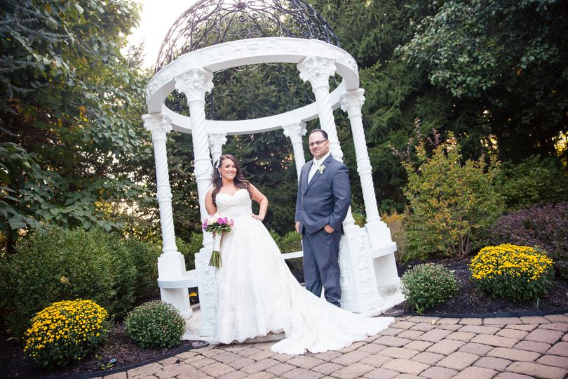 Newlyweds in the garden | Photo by Montclair Studio