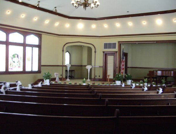 "A view of the curved, 'Kansas Style"" pews."