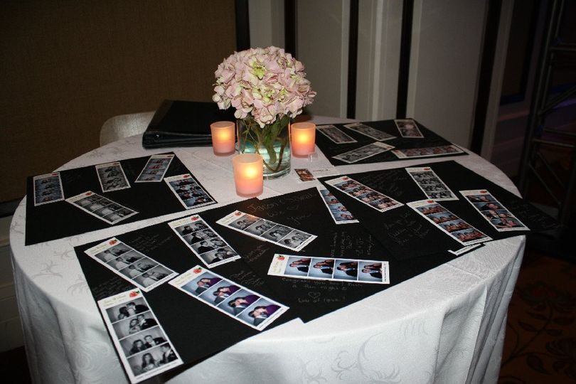 Table of guestbook photos