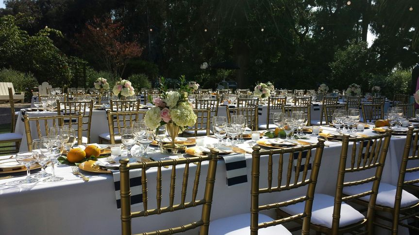 The long tables and the golden chairs
