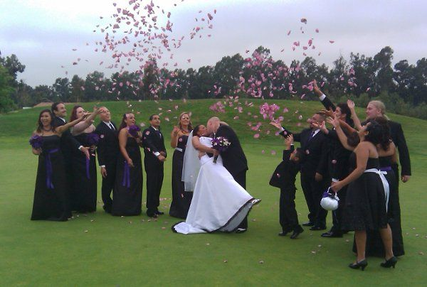 Charlie and Crystal get showered with petals on the putting green