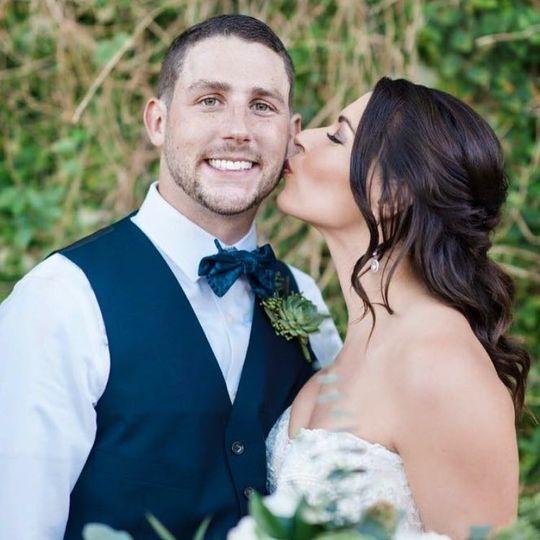 Bride kisses