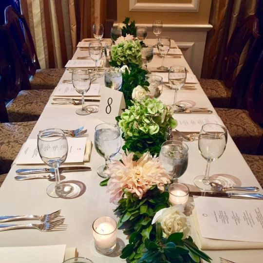 Table setting and wedding garland with flowers
