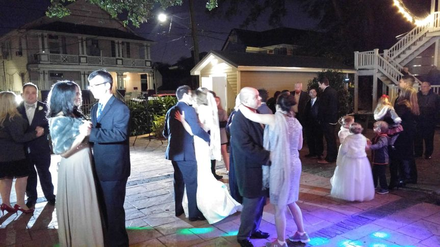A lovely couple enjoying the company of their friends during the Wedding Party Dance