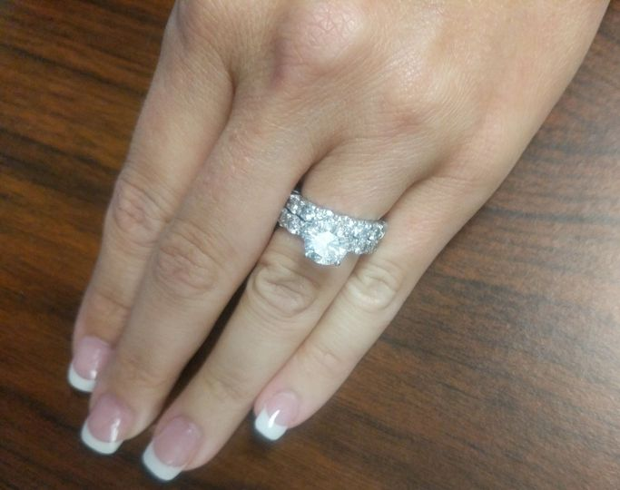 Custom-made 2 carat platinum engagement ring with matching wedding band.