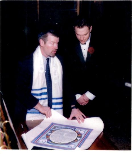Reading ketubah to groom.