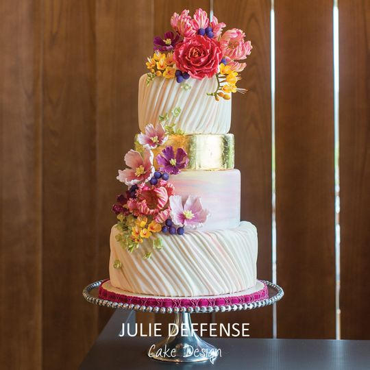 White wedding cake with floral decors