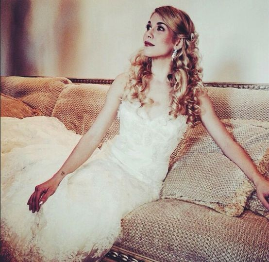 Bride poses on couch