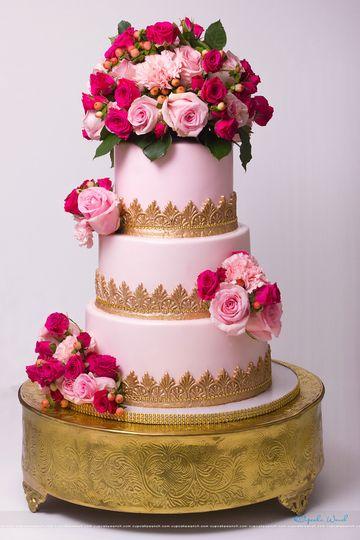 Beautiful pale pink wedding cake using fresh flowers
