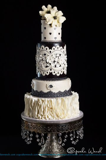 We loved that this bride was not afraid of using black on her cake.  This cake was designed to...