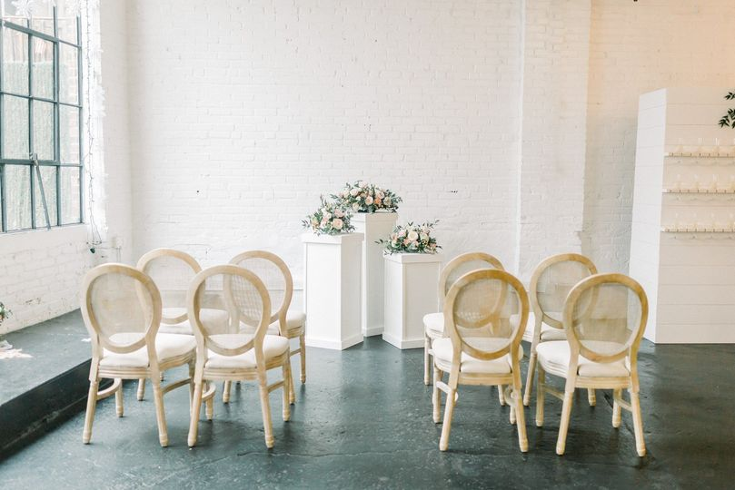 Rattan chairs and pedestals