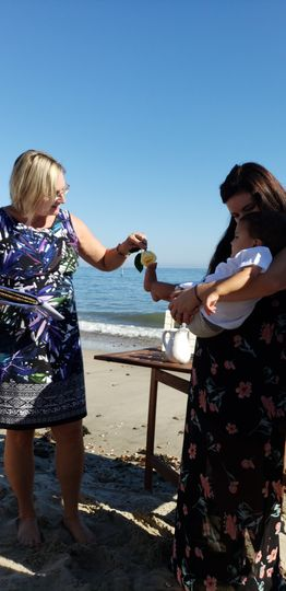 Baby blessing at the beach