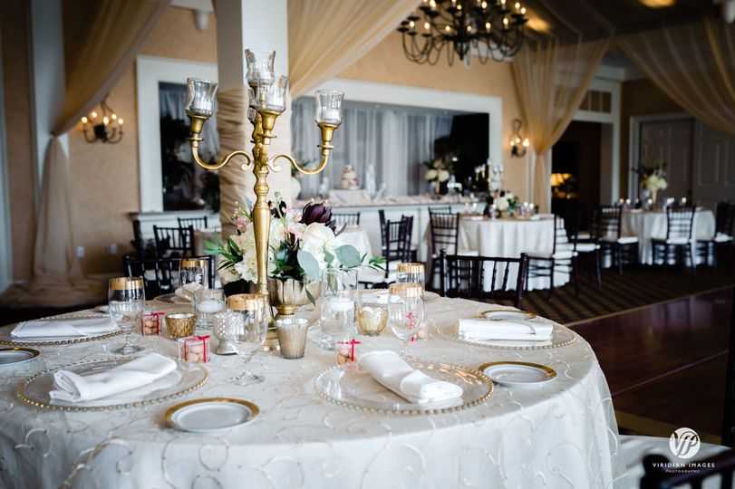 Table setting and gold centerpiece