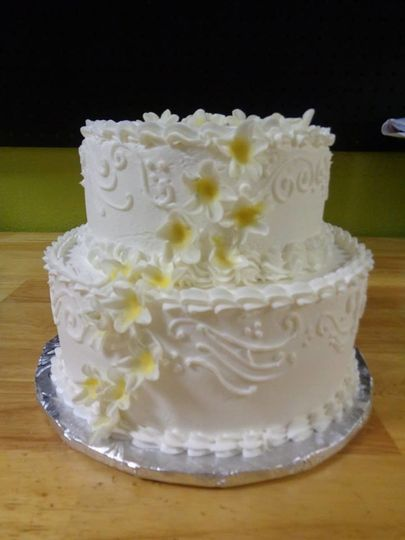 Two tier wedding cake with yellow flowers