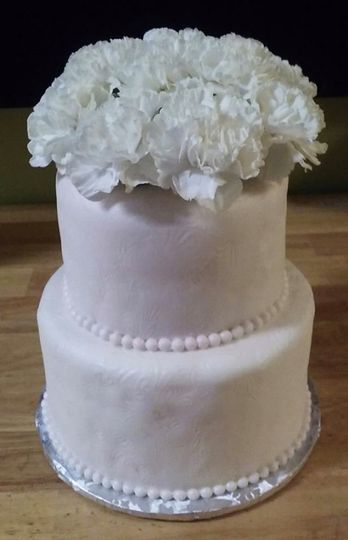 Two tier cake with flowers on top
