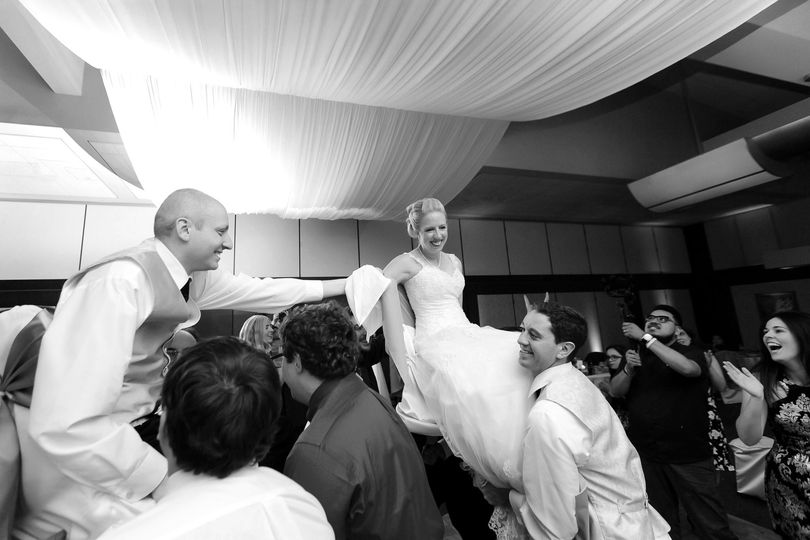 Couple and their guests dancing in black and white