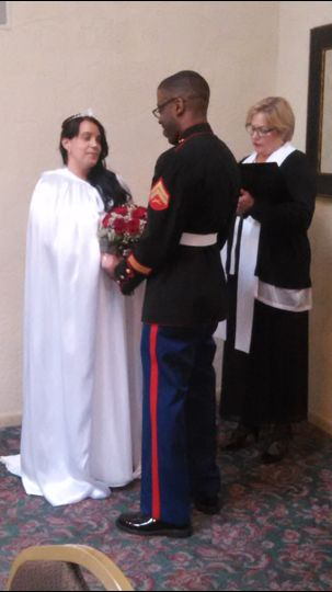 Sandra and Lionel were married in May. Lionel has a purple heart pinned on the chest of his uniform....