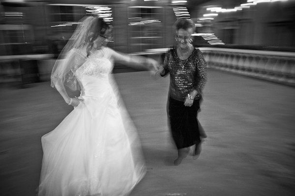 Bride & her mother dancing in the Courtyard at Gaslight Square