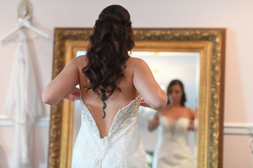 Bride putting her gown on