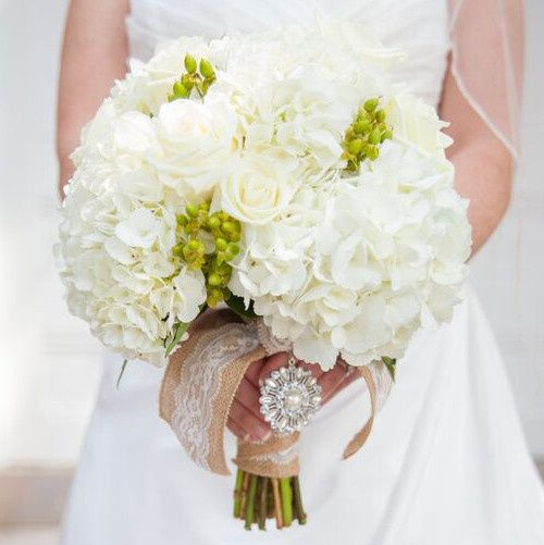 We created this stunning bridal bouquet based on the bride's all-white with pops of green request.