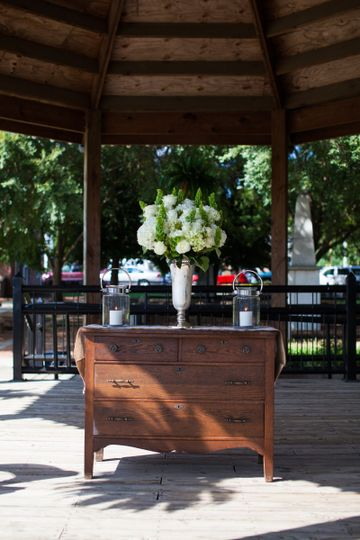 We provided day-of rentals, such as this beautiful  antique dresser-turned-altar, burlap and lace...