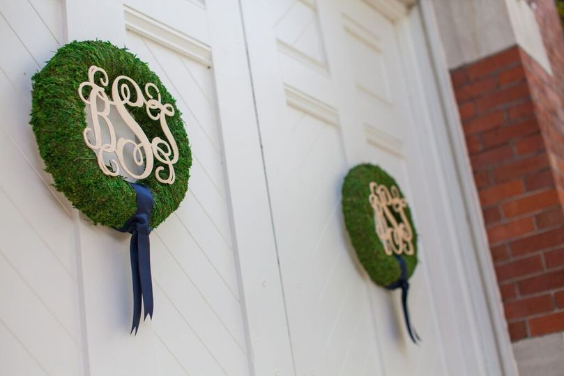We created these moss-covered wreaths with custom wooden monograms.