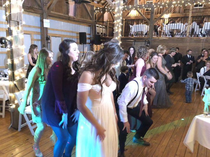 Everyone's having a great time at this barn wedding!