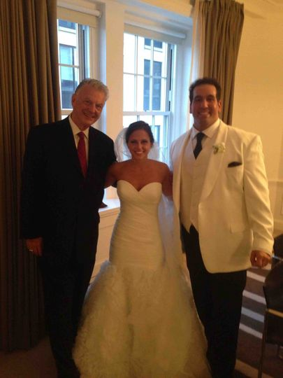 The reverend with the bride and groom