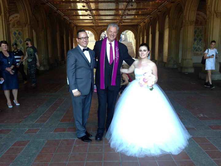 Reverend with the newlyweds