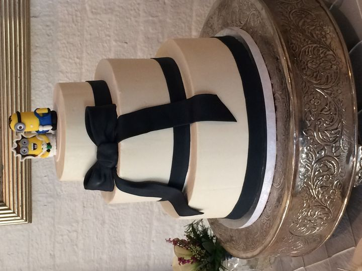 3-tier buttercream, Navy Fondant base ribbons & bow - Minion topper ordered from Etsy